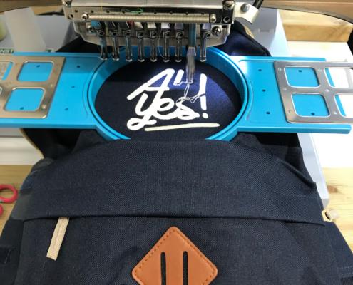 borduren logo op rugzak